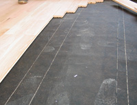 Then We Covered The Entire Floor With 15 Felt Paper And Installed Hardwood Flooring Over New Plywood Existing