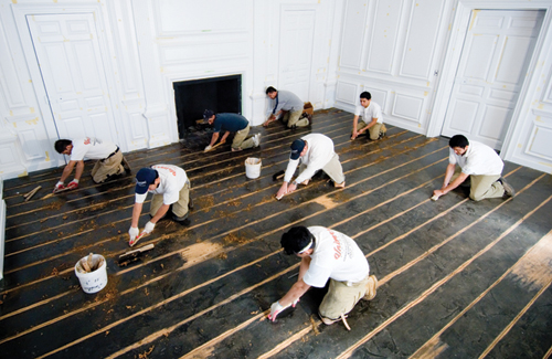 Then the floor was hand-rubbed with a fine-grit abrasive, after which a  proprietary dye was used. Finally, the floor was finished with several thin  layers ... - 200+ Wood Floor Of The Year Photos Since '99; 2016 Voting Ends