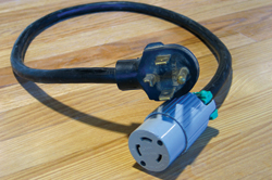 This pigtail for connecting the 3-wire to a 4-wire outlet might be illegal—it depends if the white and green wires are joined together inside the cord (joining them is illegal).
