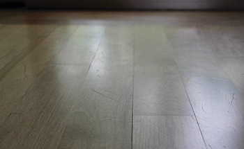 photo of a scratched floor after
