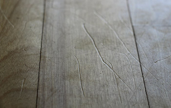 photo of a scratched floor before