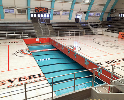The U0027Swim Gymu0027 Court Retracting Underneath The Arenau0027s Bleachers. (Courtesy  Pacific Floor)