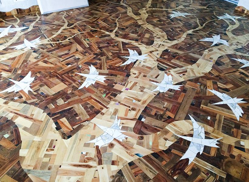 russian designer uses scrap wood for floor that climbs walls wood