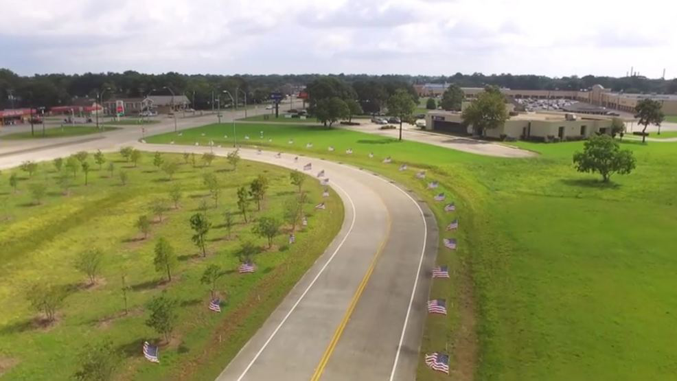 Flags positioned along a right of way in front of Summer's Abbey Flooring Center. Source: KFDM.
