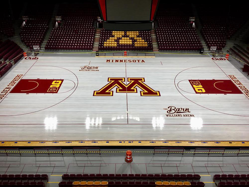 "The maple flooring of the historic Williams Arena, AKA ""The Barn,"" was given a new look by Athletic Performance Solutions over the summer. (Photos courtesy of Michael Blexrud)"