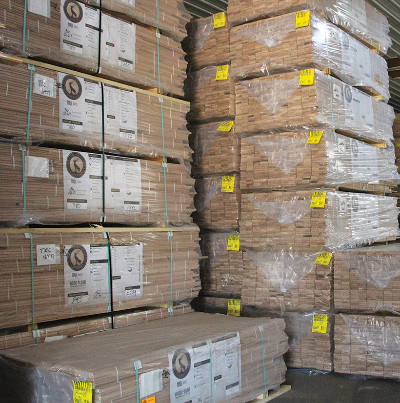 (11) Stacks of flooring are placed in the finished products warehouse, ready to be shipped.