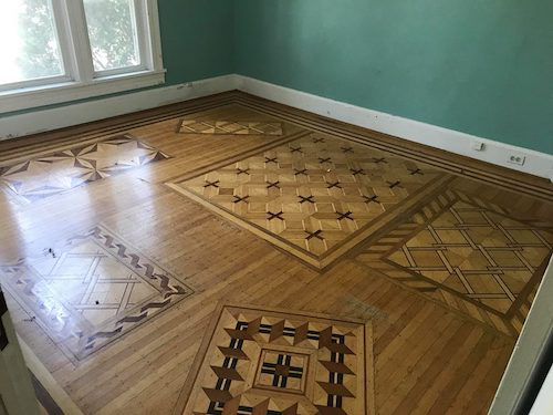 The parquet flooring used during the 1893 World Fair was later installed in wood floor craftsman William Witten's home. (Image: William Witten Home Facebook page)