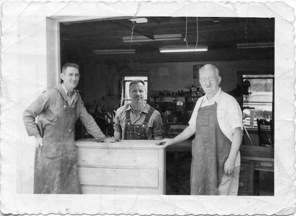 "Joseph A. Raymond (at right) and son Robert ""Bobby"" Raymond (left). I never met my grandfather, so a few years ago I combined my wood shop photo with his! Later, this popular form of woodworker's apparel would become known as ""Brickman Casual."""