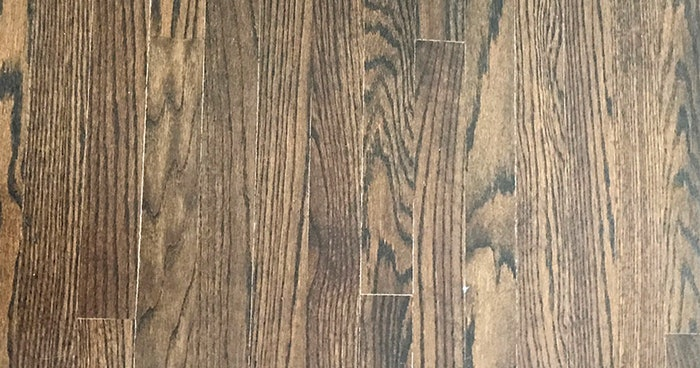 Doing a second coat of stain without sufficient dry time before coating can result in trapped solvents that create white lines along board edges (like these), or adhesion issues such as peeling and delamination. (Photo courtesy of DuraSeal)