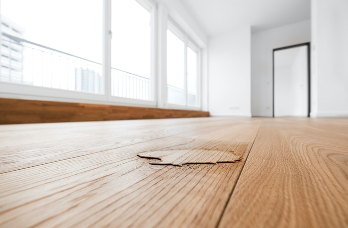 The simple test of a capful of water on a floor can help indicate if it's safe to recoat.