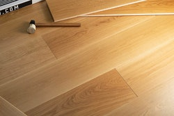 Your cutting allowance for wide plank might be greater than what it normally would be for a strip installation.